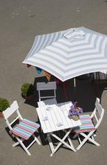 Table chairs and sun shade