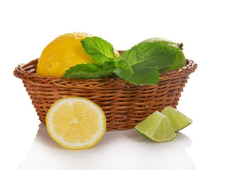 Lemon, lime and mint in basket
