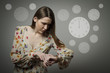 Young woman and wristwatch. 12 p.m.