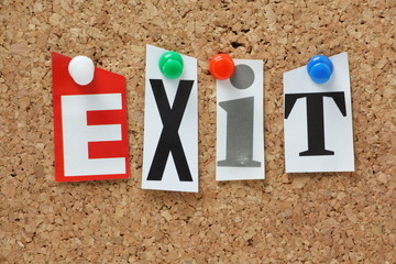 The word Exit on a cork notice board