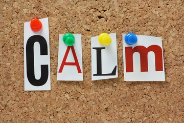 The word Calm on a cork notice board