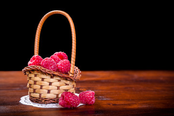 raspberry in basket on wood table