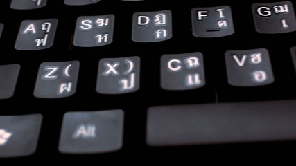 close up of keyboard english and thai alphabet. Macro