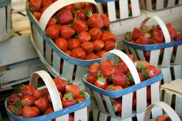 Baskets with fresh strawberries for sale.