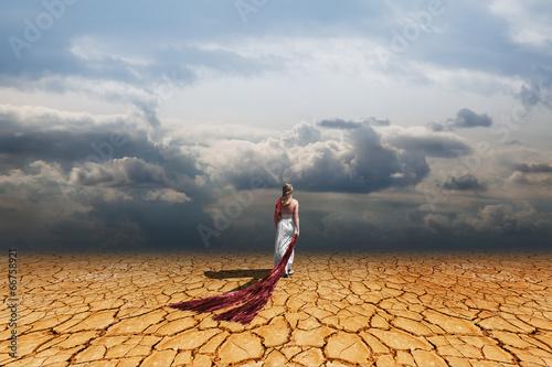 Girl walking on dry land - 66758921