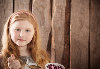 girl with dessert on wooden background
