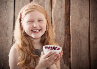 happy girl with dessert on wooden background