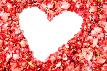 Red rose petals in shape of heart with space for text