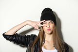 Hipster teenage girl with beanie hat posing