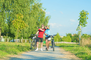Young Caucasian Couple Having a walk with Bikes