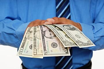 Businessman shows you money, focus is on money