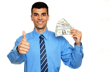 Smiling young businessman  shows you money and thumbs up