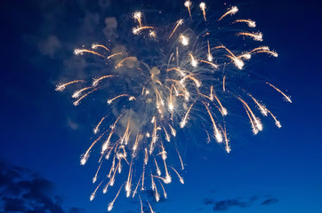 Fireworks on the background of blue sky