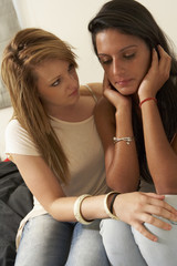 Unhappy teenage girl with friend