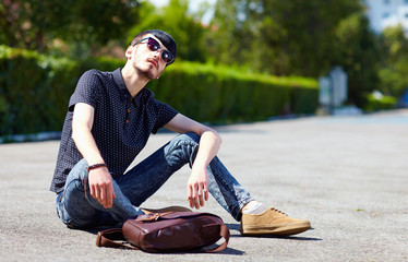 young adult boy posing on the ground