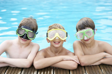 Boys in outdoor swimming pool