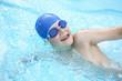 Leinwanddruck Bild - Boy swimming in outdoor pool