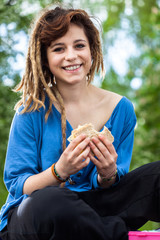 Teen girl with sandwich