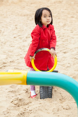 Asian child spending time on the playground