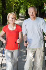 Married couple practicing nordic walking