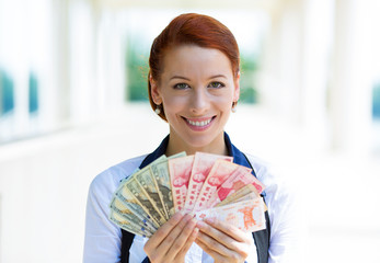 Business woman holding showing currency of different countries