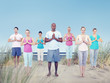 canvas print picture - Group of People Doing Yoga at Beach