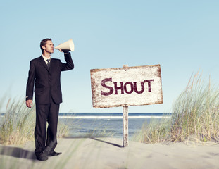 Businessman Holding loudspeaker with Signboard on Beach