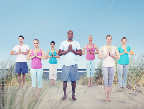 canvas print picture Group of People Doing Yoga at Beach