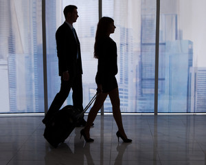 Business People Walking With Luggage In Office