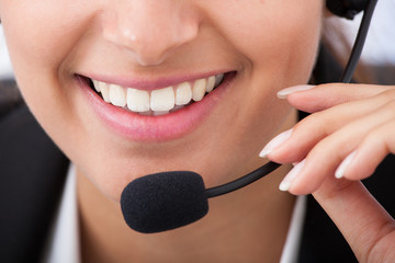 Smiling Young Businesswoman Talking On Headset