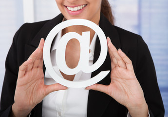 Businesswoman Holding Internet Symbol