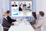 Business People In Video Conference At Table - 66768591