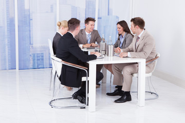 Business People Discussing At Conference Table