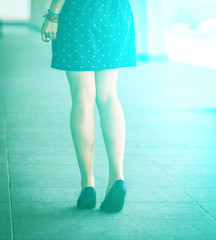Beautiful, women's legs in shoes. With sunshine effect.