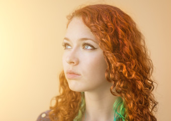 Portrait of young redhead woman. With sunshine effect.