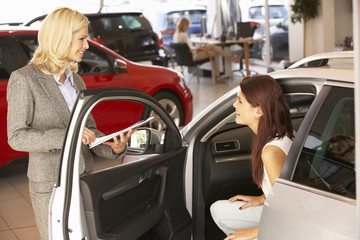 Young woman buying new car