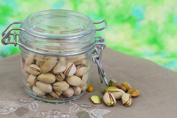 Pistachio nuts in vintage glass jar with copy space