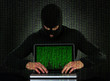 Hacker Using Laptop With Binary Code