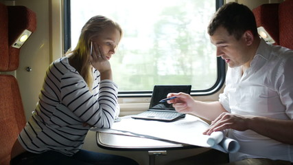 Man and woman discussing drawing during business trip in the