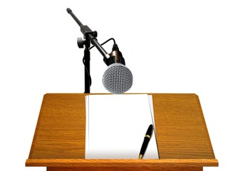 Podium with Microphone and Blank Papers