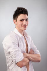 Healthy muscular young man on grey background