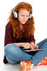 girl is listening music and using tablet pc