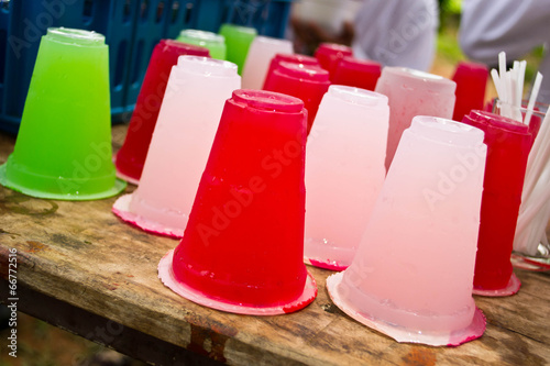 Soft drinks in plastic cups - 66772516