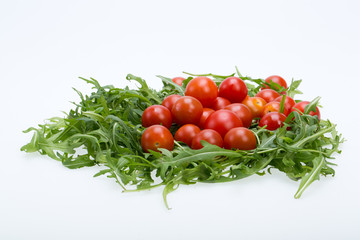 Heap of ruccola leaves and cherry tomatoes