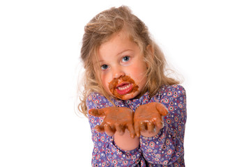 girl with chocolat on hands and mouth