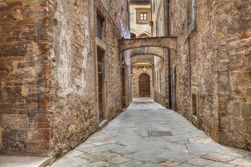 ancient alley in Volterra, Tuscany, Italy