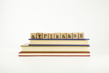 afrikaans language word on wood stamps and books