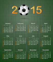 Soccer calendar for 2015 on green linen texture