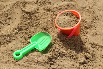 Colorful toys for children's sandboxes on the sea beach