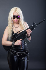 Beautiful sexy girl with a rifle